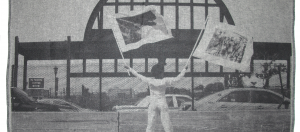 Holding Two Flags Across Westside Highway Facing Pier 54, 2015